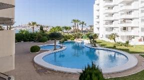Mooi appartement te koop in Marina Botafoch op Ibiza met groot zwembad en mooi uitzicht