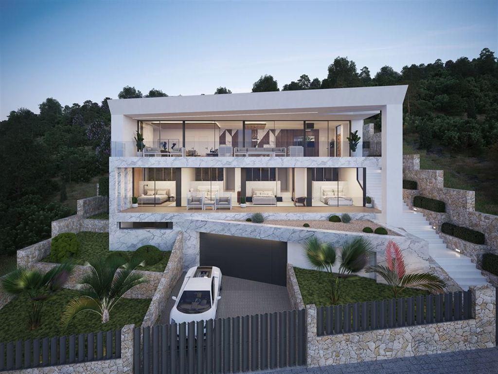 Luxe villa met uitzicht op de Middellandse Zee en een open uitzicht op Ibiza