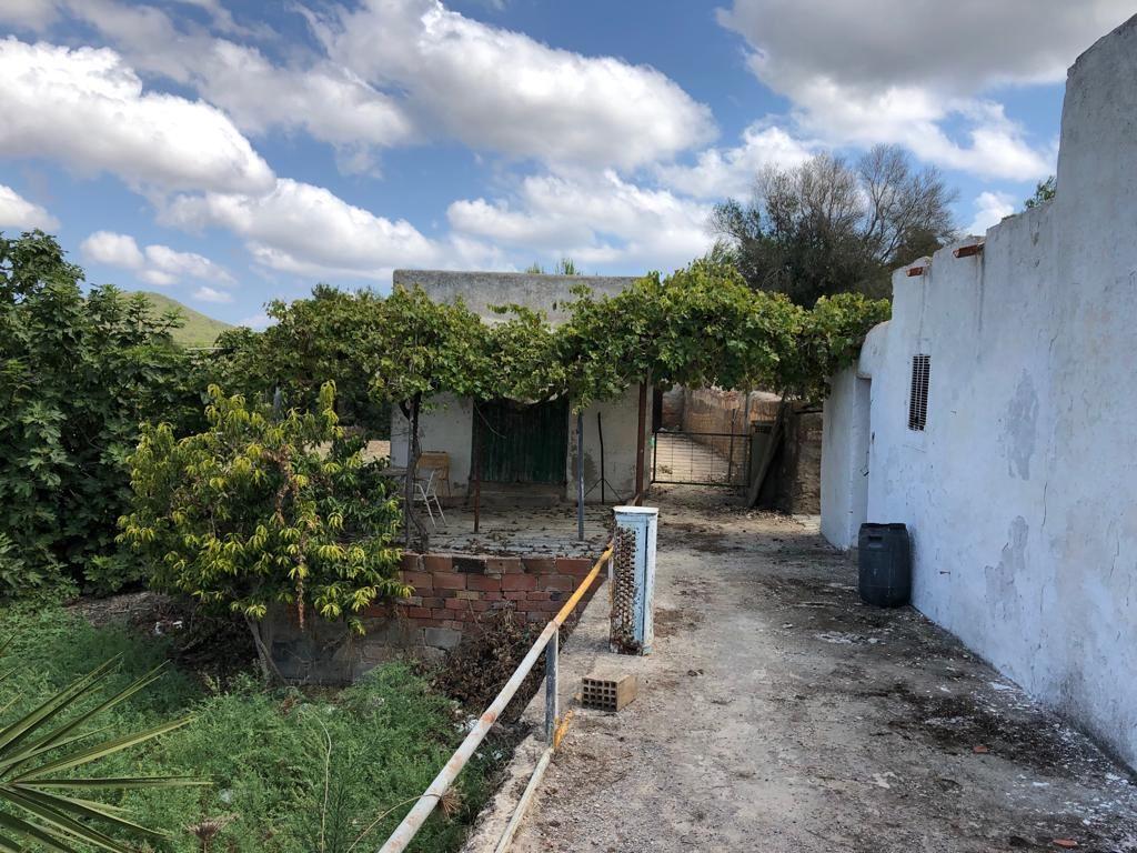 Groot perceel in San Carlos met groot huis te koop